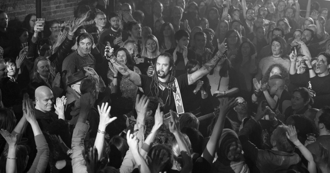 Michael Franti performing from the crowd at his gig in London in 2016